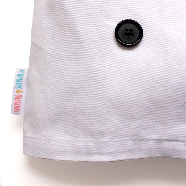 The rolled hemline of a 100% cotton twill, children's Chef jacket costume