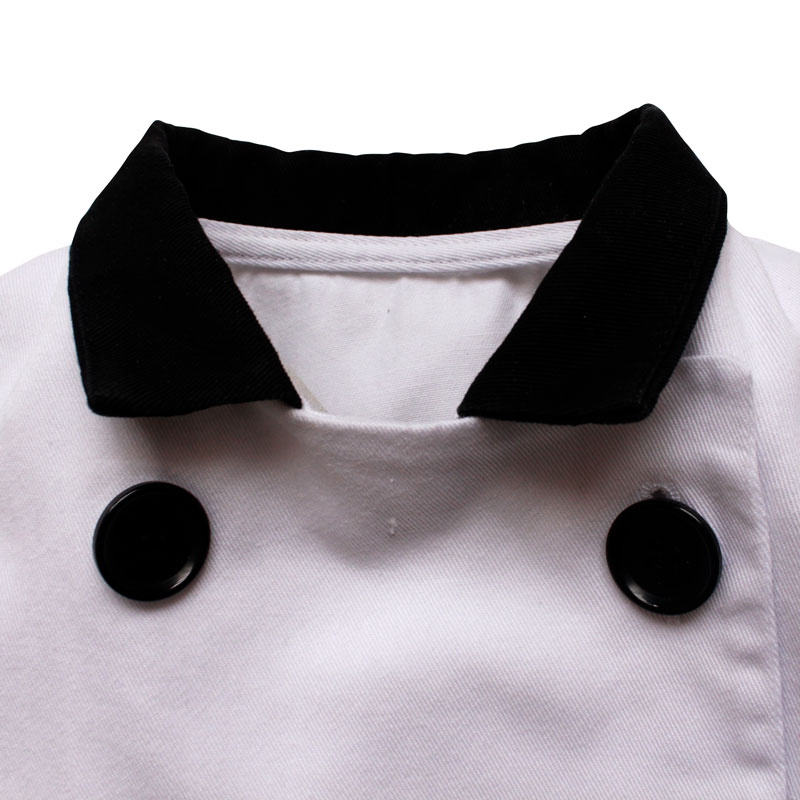 Up close collar detail of a White, 100% cotton twill childrens chef cross-over jacket with a a black stand up collar and round black 4-hole button