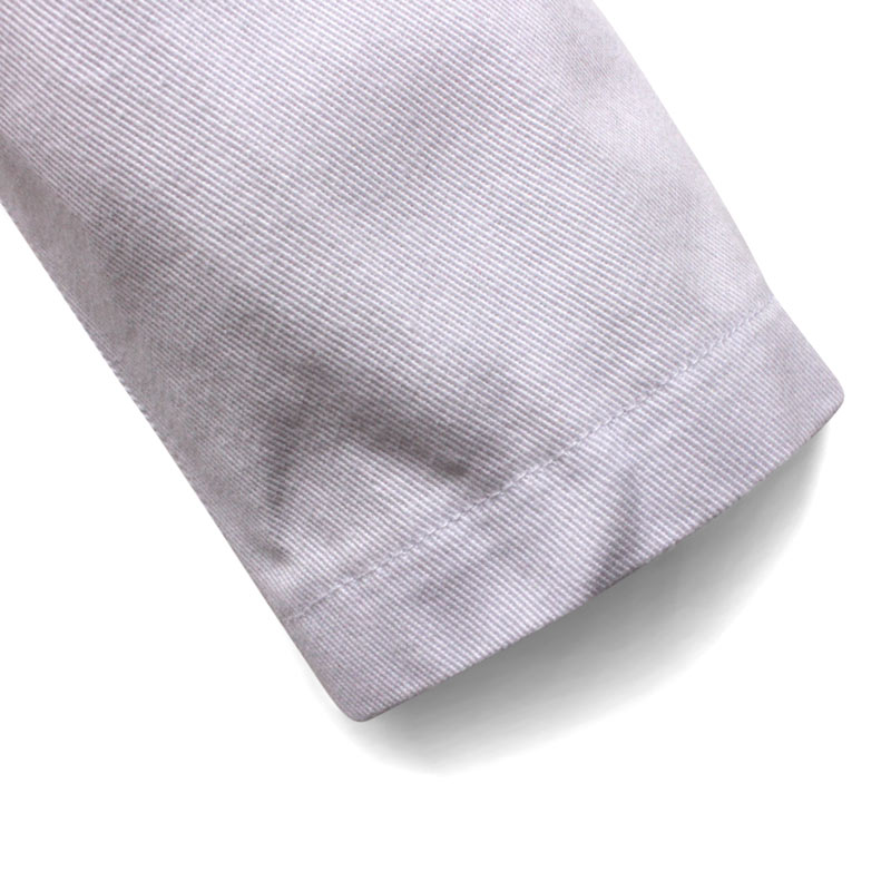 close up of a Children's white chef jacket sleeve cuff in cotton twill and rolled cuff