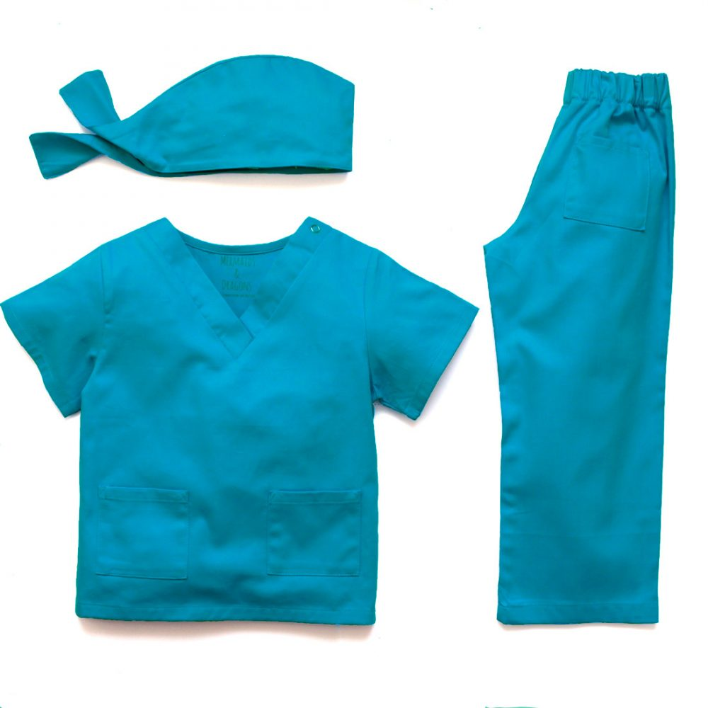 Childrens 3 piece medical scrubs uniform in blue cotton twill including a shortleeved top with 2 front pockets, trousers with elasticated waist and a tie close skull cap