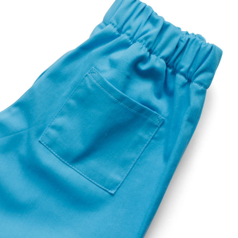 Up close view of the back pocket on Childrens blue cotton twill scrubs trousers